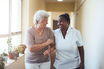elderly woman and her caregiver smiling