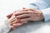 elderlies holding their hands
